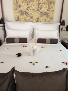 elephant and petals on bed